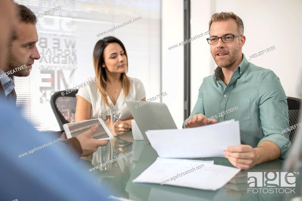 Stock Photo: Colleagues having a meeting in office boardroom.