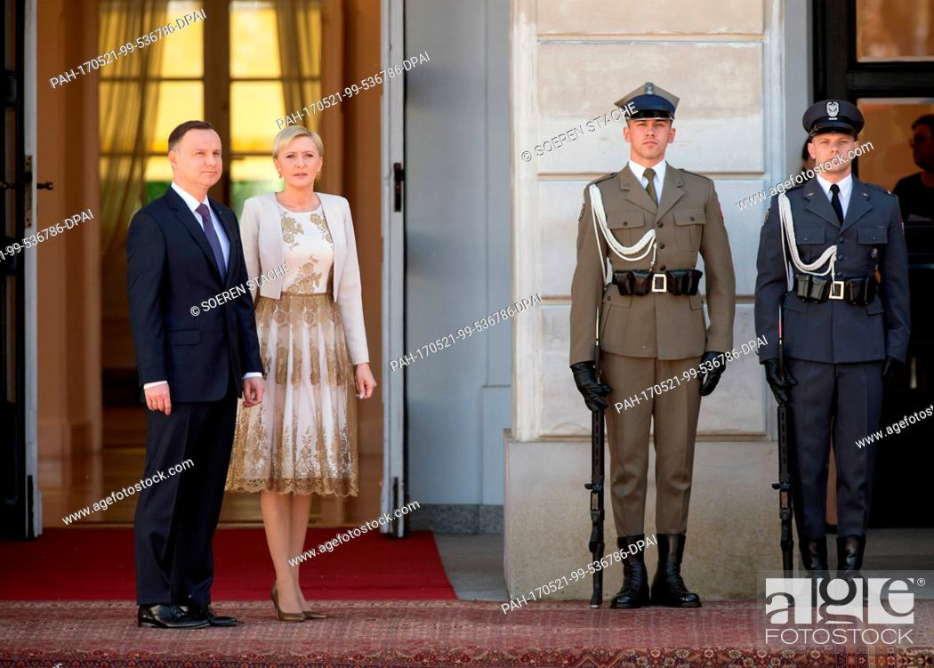 Stock Photo: Polish President Andrzej Duda (L) and his wife Agata Kornhauser-Duda (2-L) await the arrival of German President Frank-Walter Steinmeier (not pictured) in front.