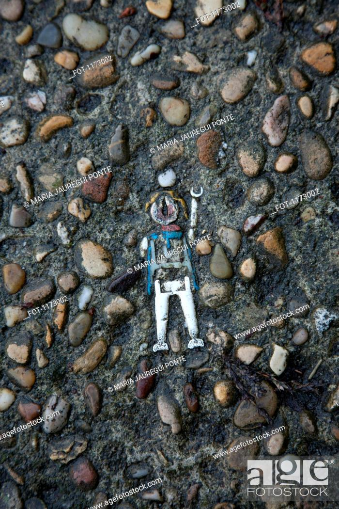 Stock Photo: Toy lodged in cement.