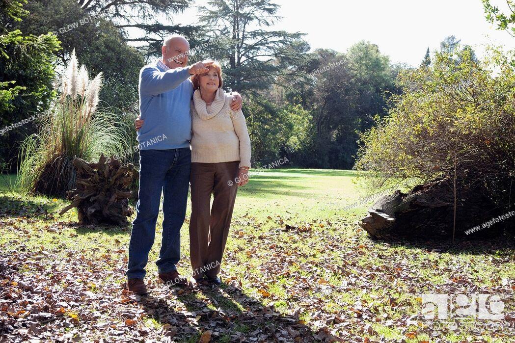 Stock Photo: Couple enjoying in a park.