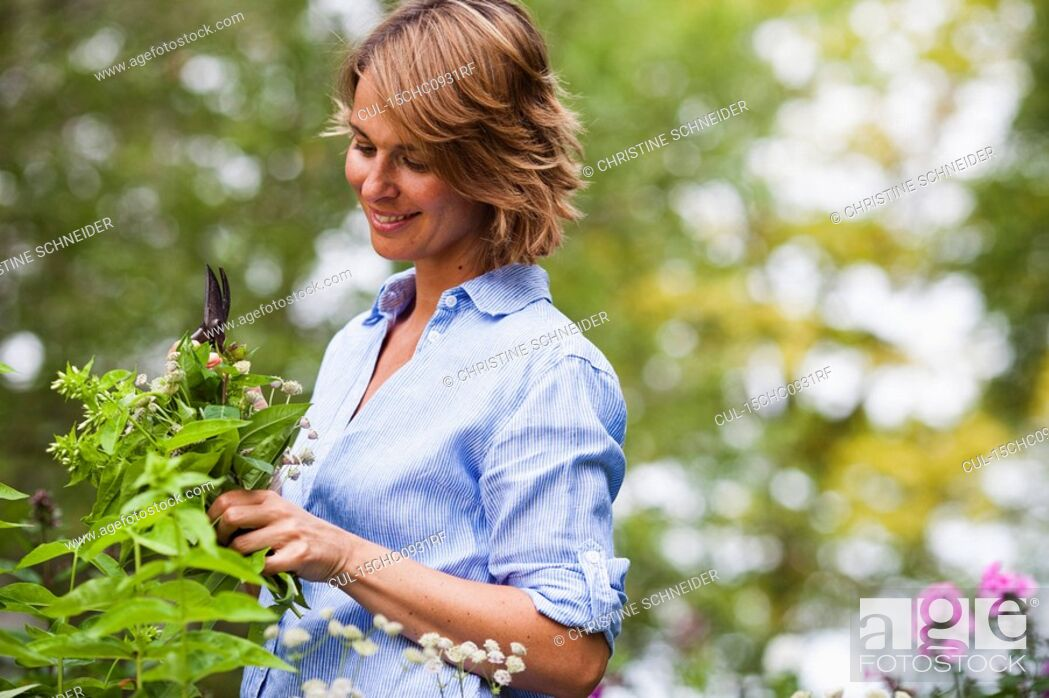 Stock Photo: woman taking care of plants.