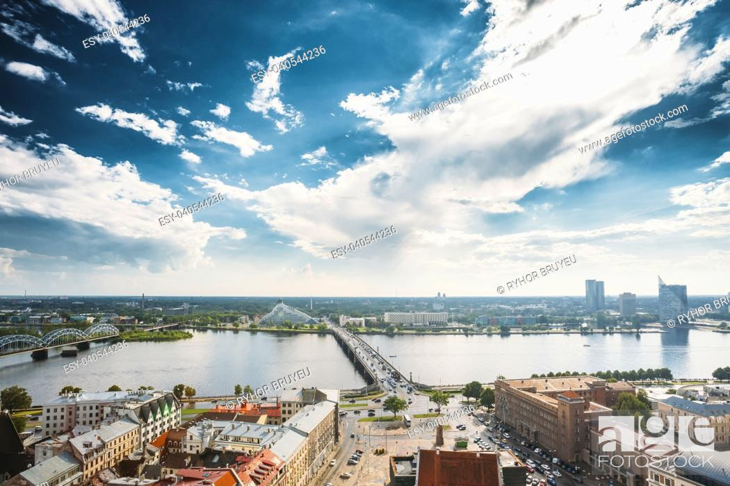 Stock Photo: Riga, Latvia. Traffic On Akmens Tilts - Stone Bridge Street In Summer Day. Top View, Aerial View Of National Library Building.