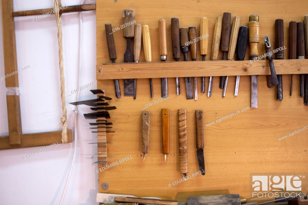 Stock Photo: Tools of a luthier on the wall.