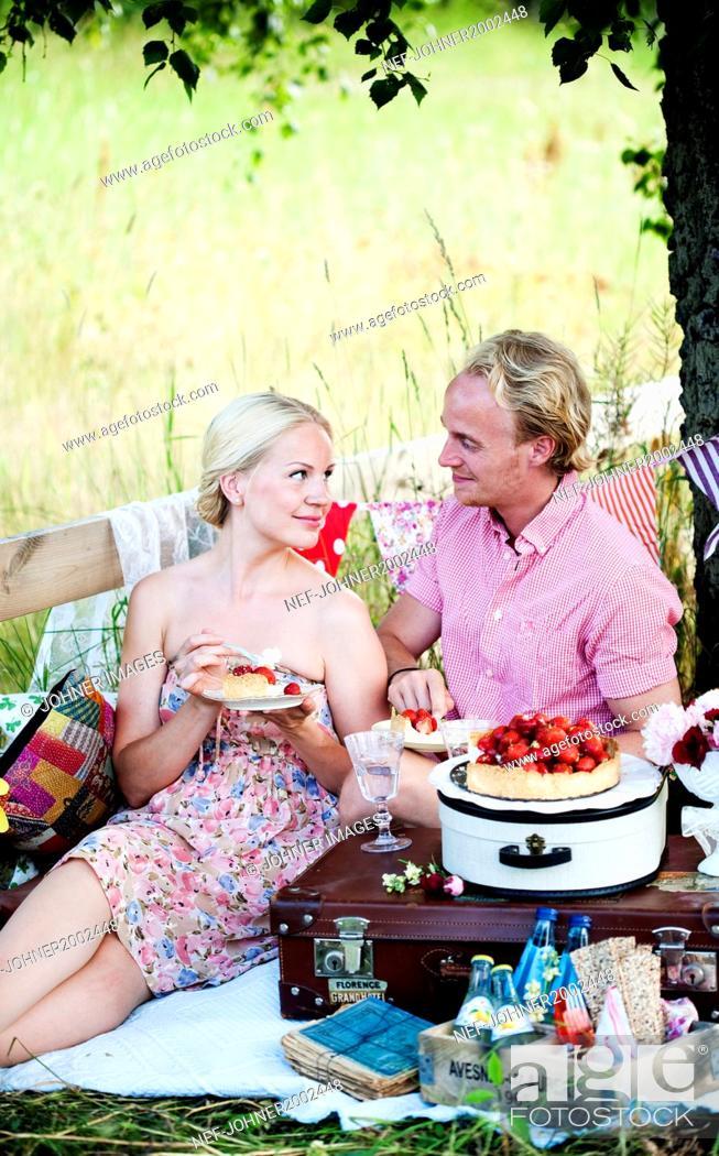 Stock Photo: Mid adult couple having picnic.