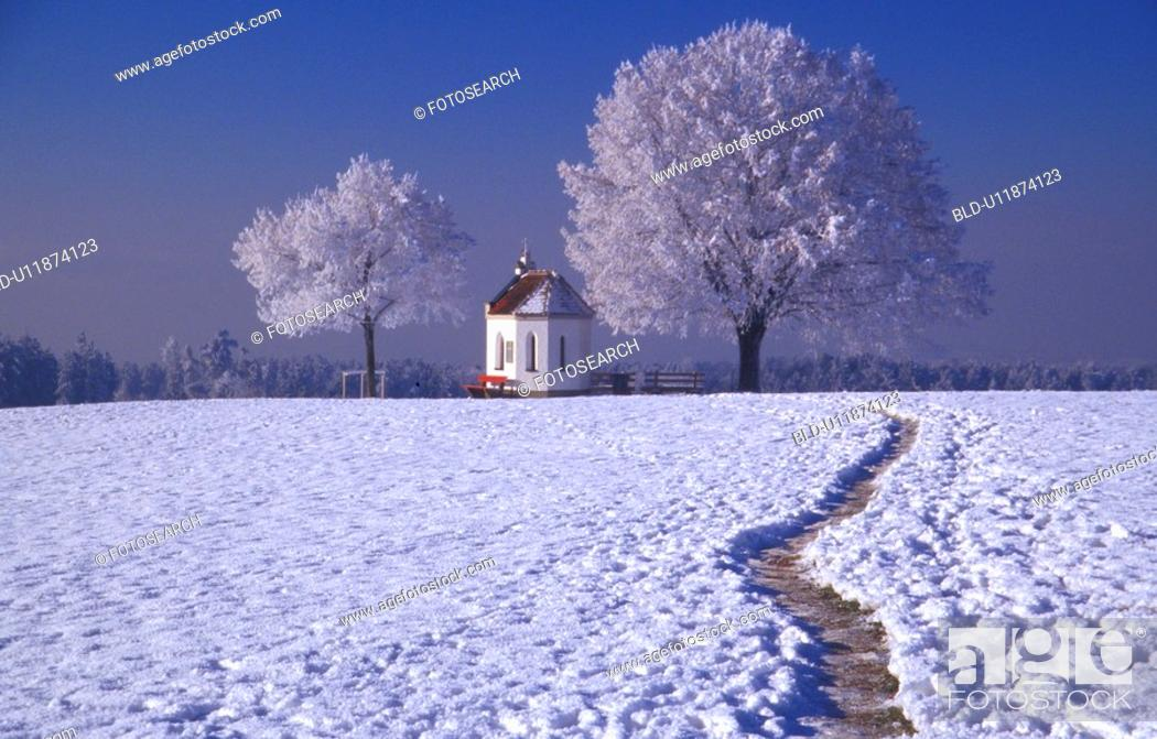 Stock Photo: Snow covered footpath to church.