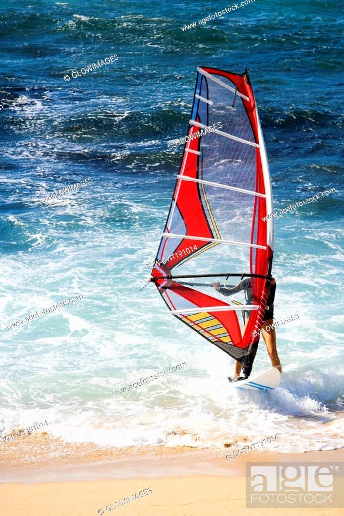 Stock Photo: Man windsurfing in the sea, Hookipa Beach, Maui, Hawaii Islands, USA.