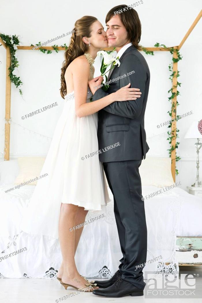Stock Photo: Bride kissing groom.