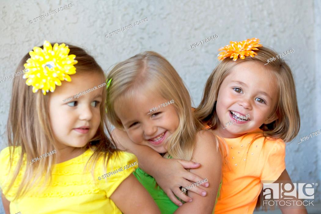 Photo de stock: three girls being playful.