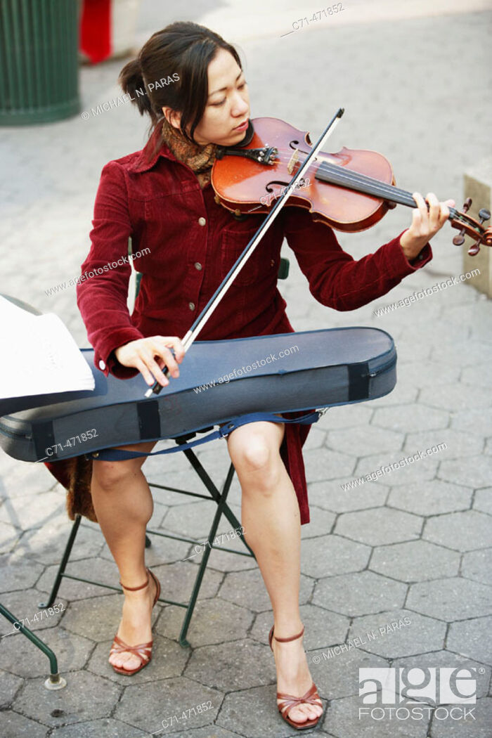 Stock Photo: Asian woman playing the violin.