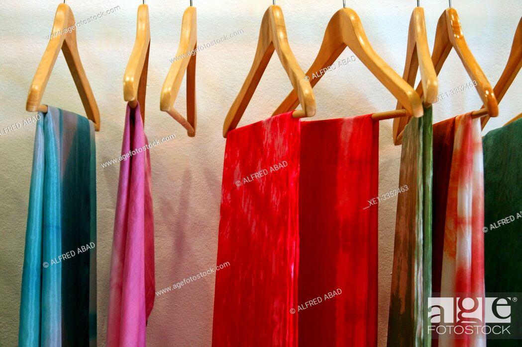 Stock Photo: hangers, atelier of natural textiles, Ikaten shop, Gracia District, Barcelona, Catalonia, Spain.