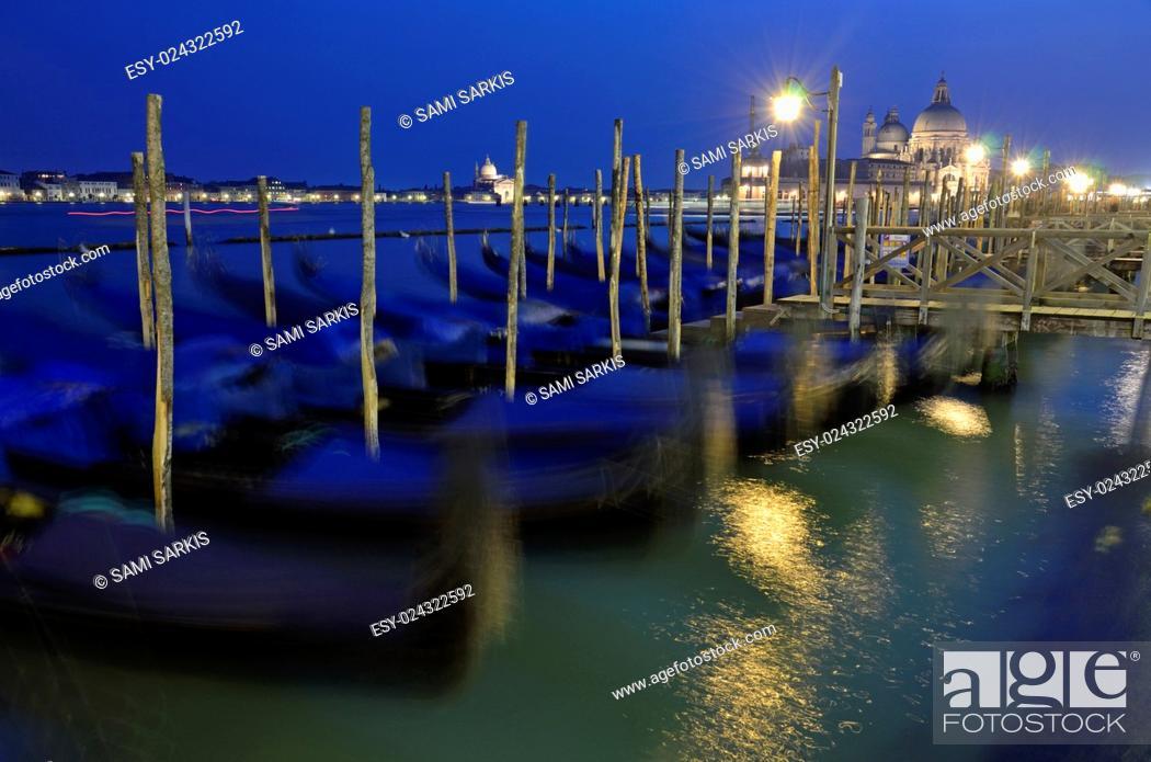 Stock Photo: Santa Maria della Salute and gondolas at night, Venice, Italy (long exposure).