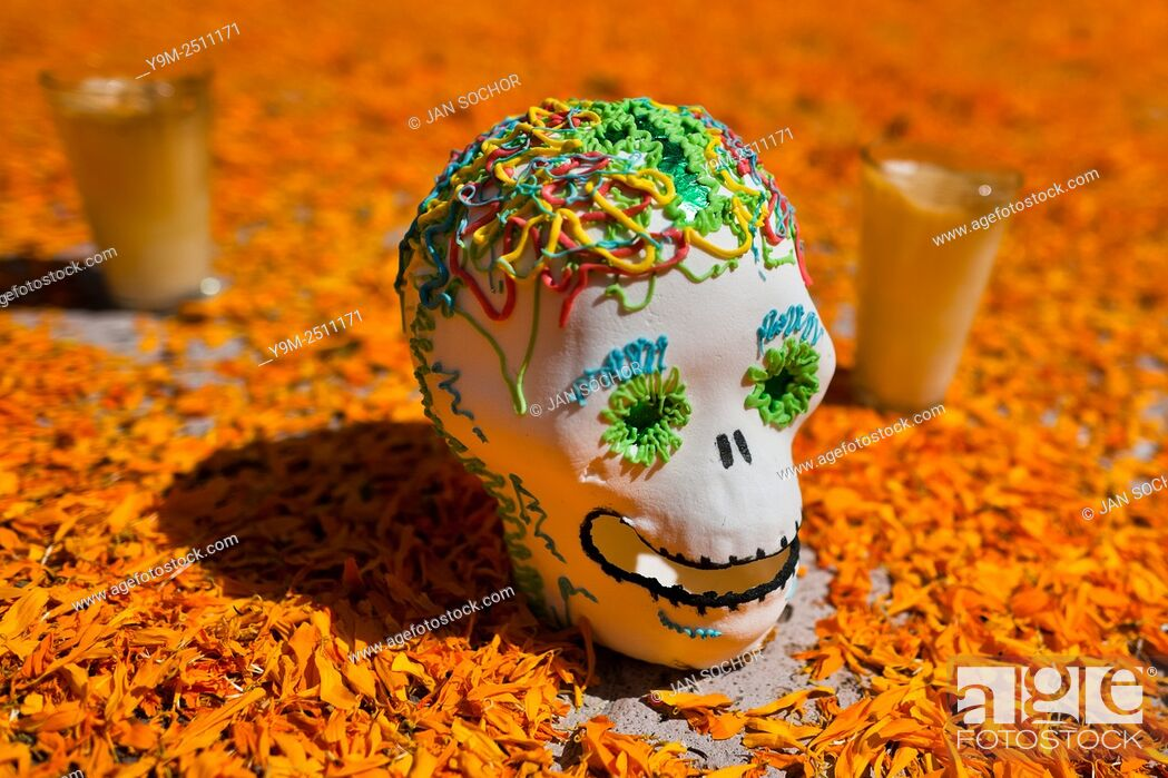Stock Photo: A decorated scull is placed at the altar of the dead (altar de muertos), a religious site honoring the deceased, during the Day of the Dead festival in Morelia.