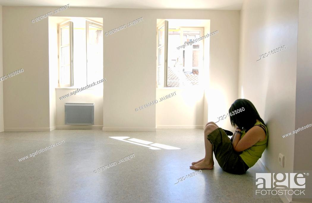 Stock Photo: Girl isolated in an apartment.
