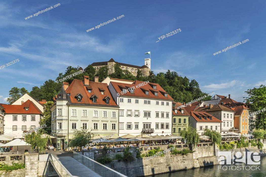 Stock Photo: View from the old town of Ljubljana over the bridge Ribja brv (fish-pier) and over the river Ljubljanica to the castle of Ljubljana.