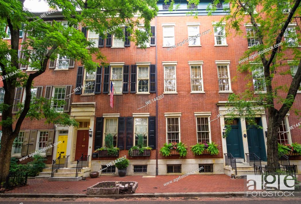 Stock Photo: Attractive brick houses decorated with flower boxes in residential neighborhood in Philadelphia.