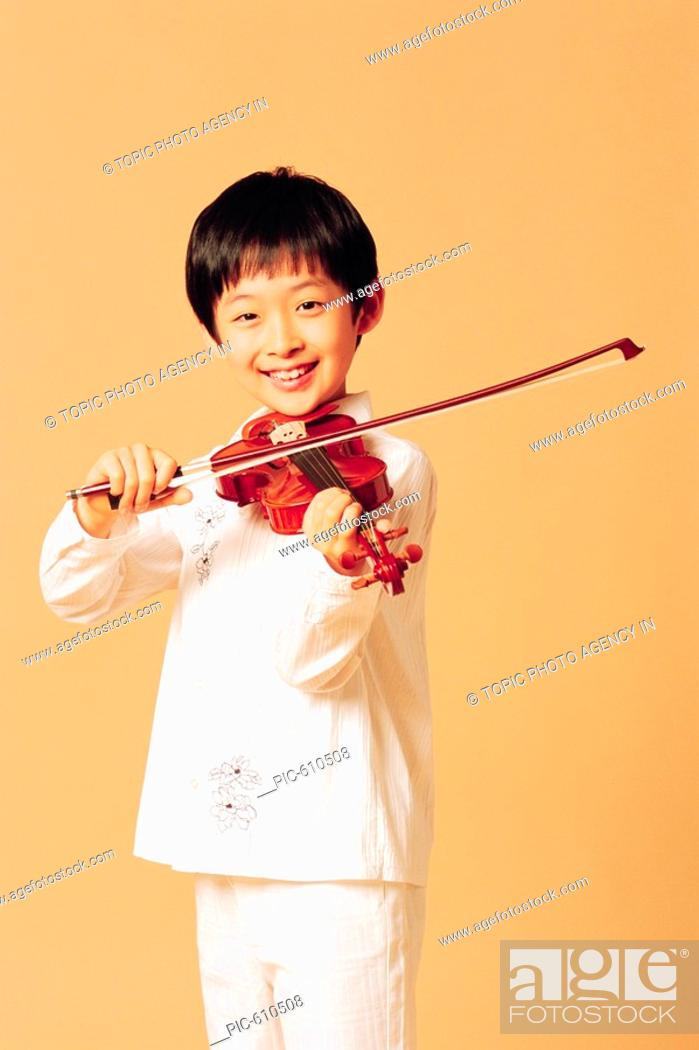 Boy Playing Violin, Korean, Stock Photo, Picture And Rights