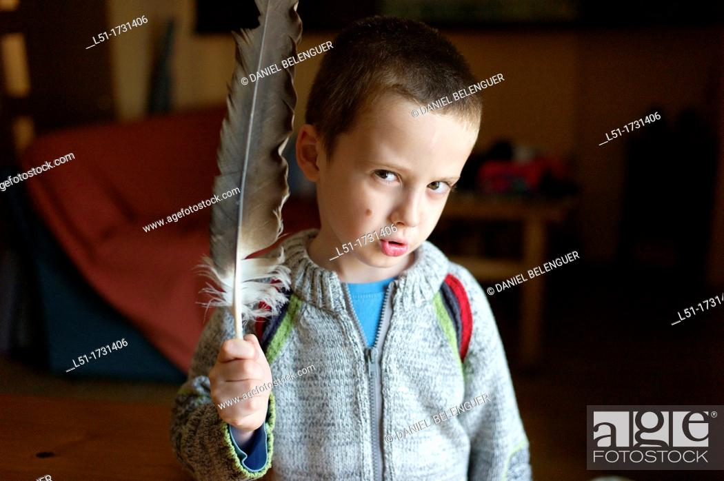 Stock Photo: Boy with a vulture feather, Ludiente, Castellón, Spain.