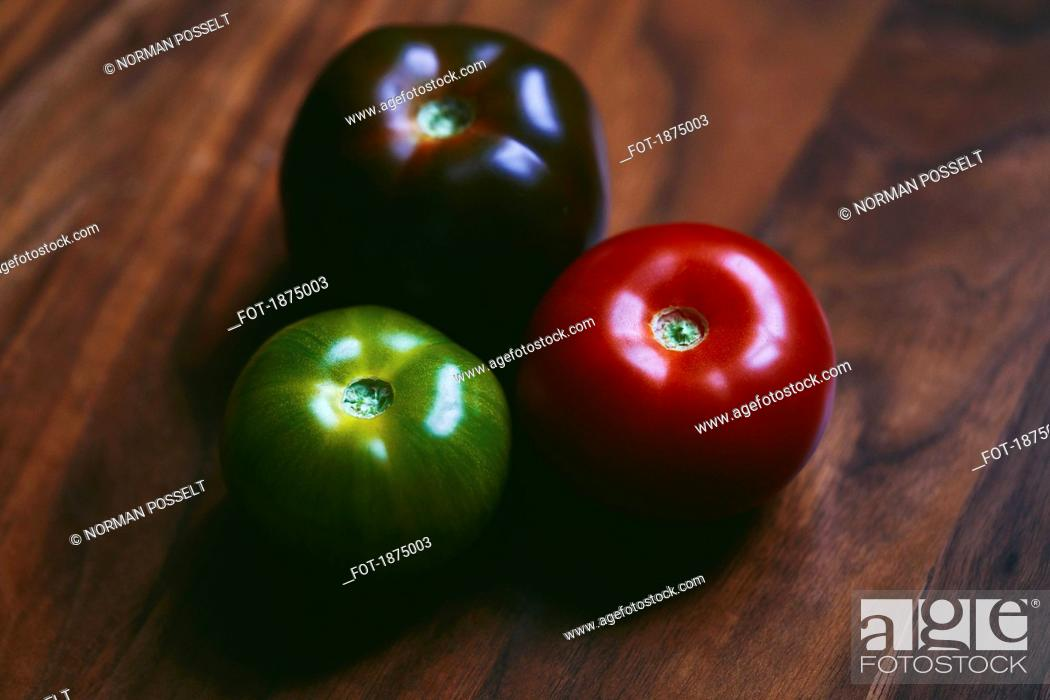 Stock Photo: Close up red, green and purple tomatoes.