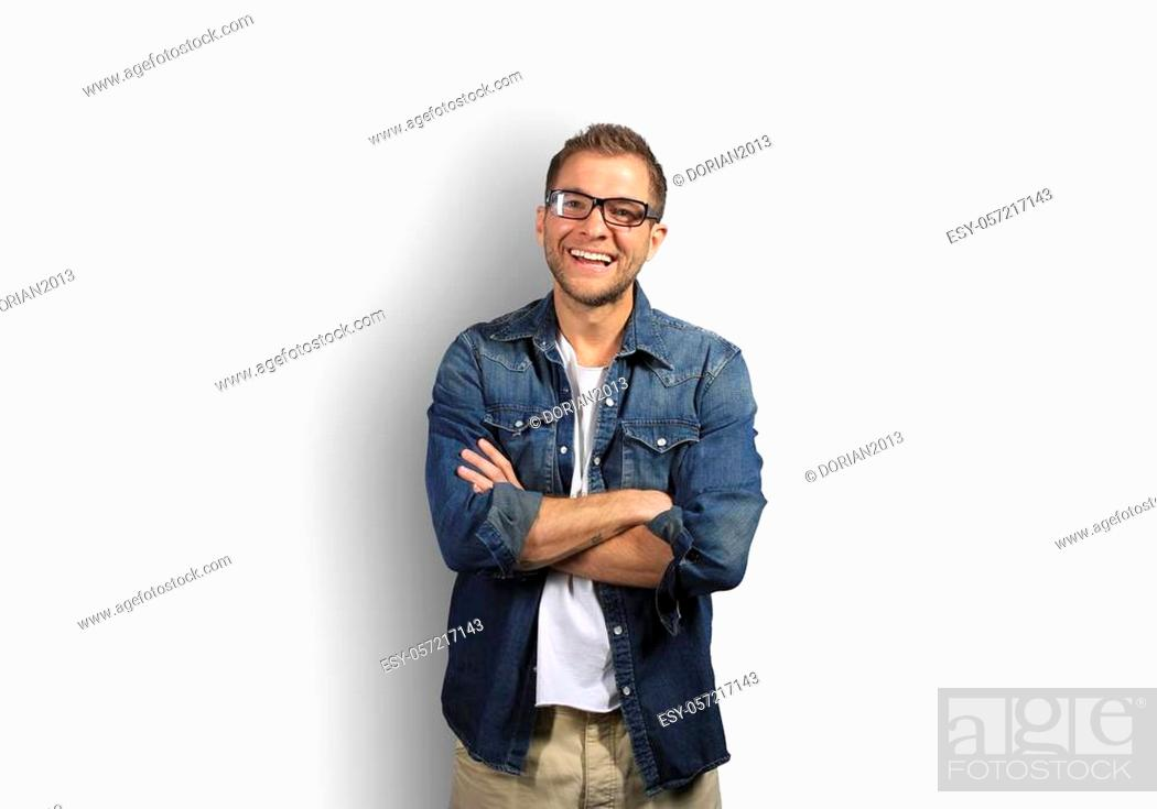 Stock Photo: Young man in denim shirt is smiling.