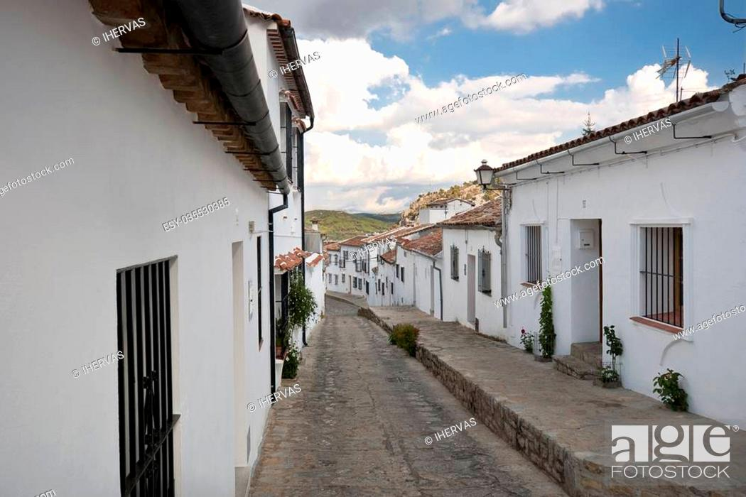 Stock Photo: Traditional white houses in Grazalema town, Spain. This village is part of the pueblos blancos -white towns- in southern Spain Andalusia region.