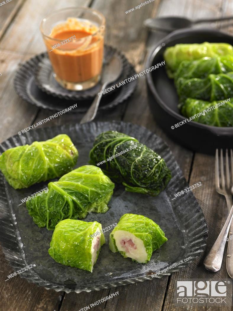 Stock Photo: hojas de col rellenas de jamon y bechamel / Cabbage leaves stuffed with ham and bechamel.