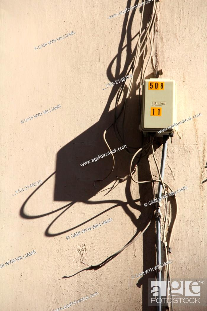 tangled electrical wires cables on wall in rome italy, Stock ... on