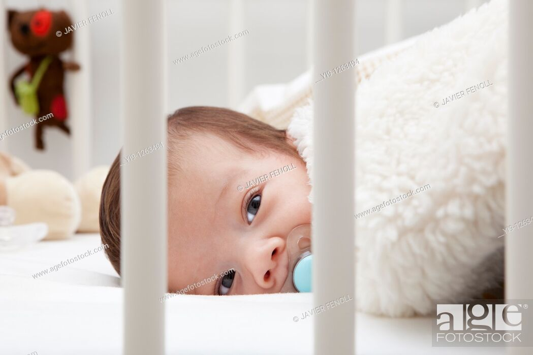 Stock Photo: Baby in cot.