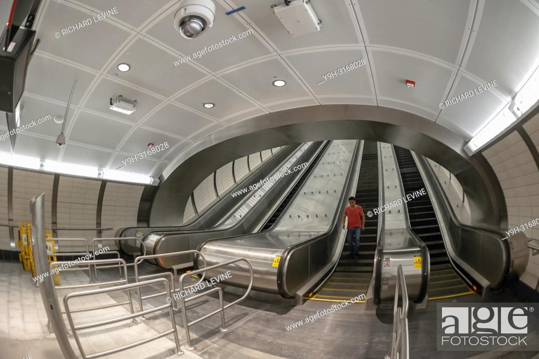 Stock Photo: High-rise escalators in the new north entrance of the 34th Street-Hudson Yards terminal station on the 7 Subway line extension in New York on its grand opening.