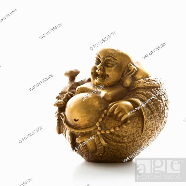 Stock Photo: Happy laughing Buddha brass figurine on white background.