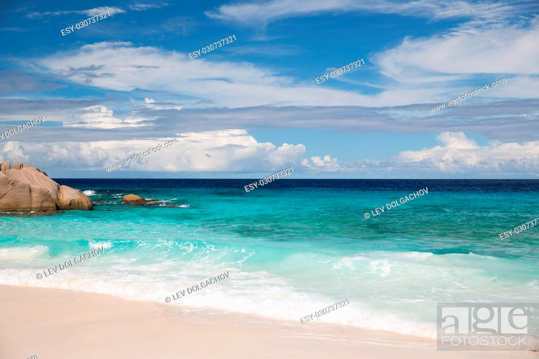 Stock Photo: travel, seascape and nature concept - island beach in indian ocean on seychelles.