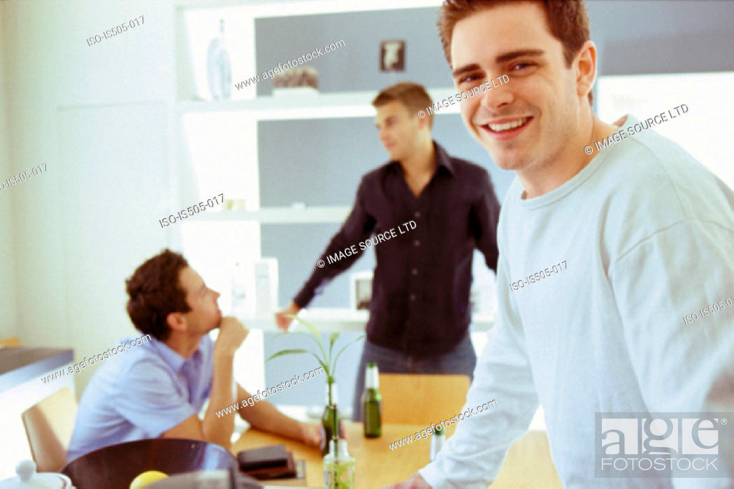 Stock Photo: Men having a drink.