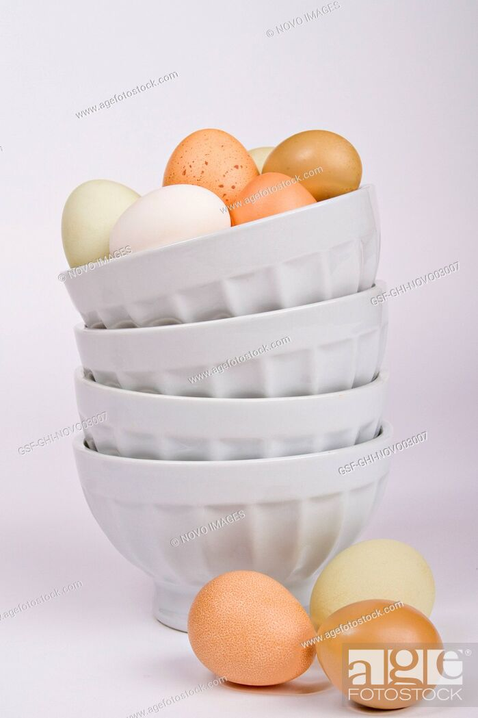Imagen: Assortment of Eggs on Top of and Next to a Stack of Bowls.