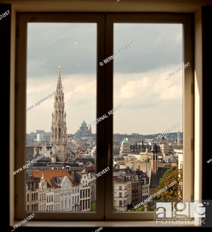 Stock Photo: View of the Town Hall tower and city centre through a window in Brussels, Belgium.