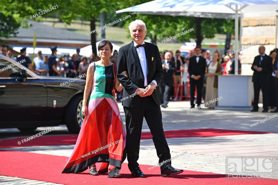 Stock Photo: Udo WACHTVEITL (actor) with his wife Lila SCHULZ. on her arrival, opening of the Bayreuth Richard Wagner Festival 2019. Red carpet on 25.07.2019.