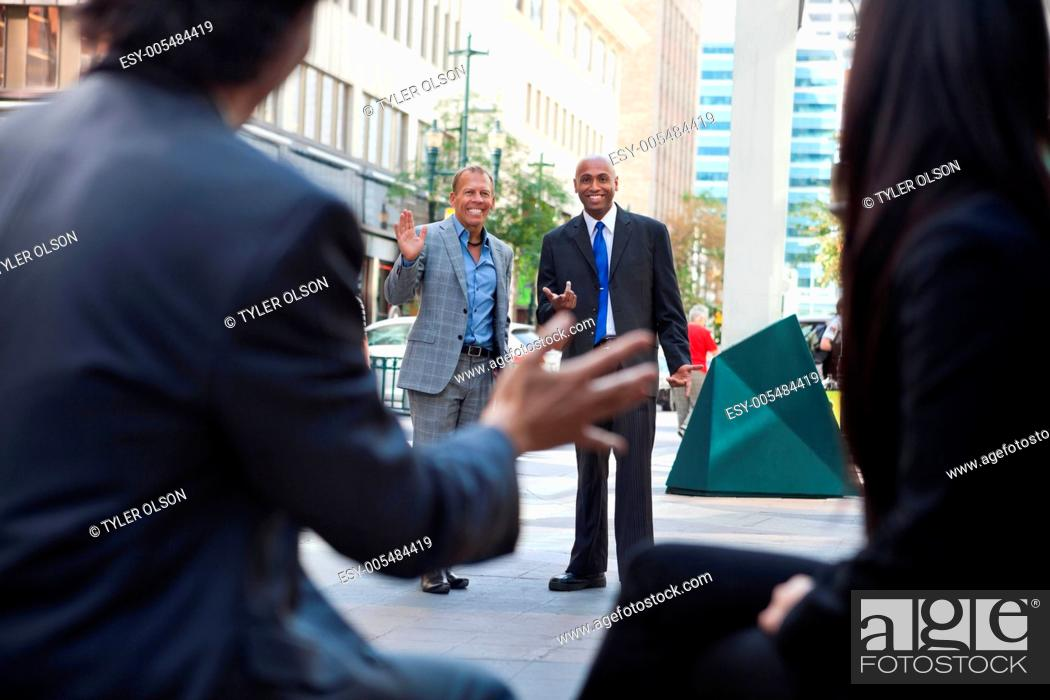 Stock Photo: Business People Greeting Each other.