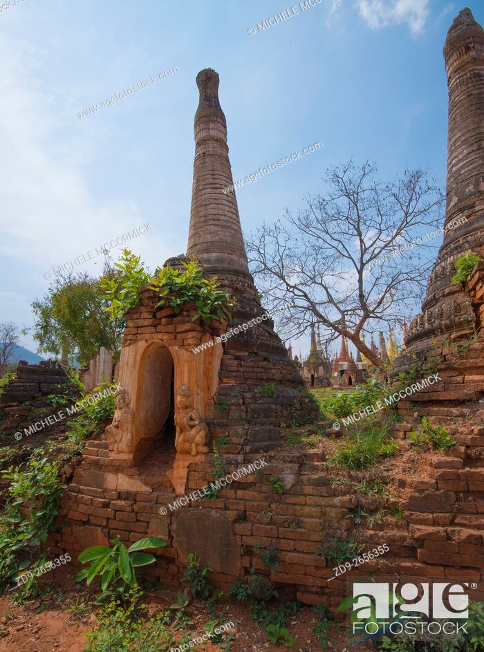 Stock Photo: Hundreds of pagodas, ancient and new, cover a hillside at Idein Lake.