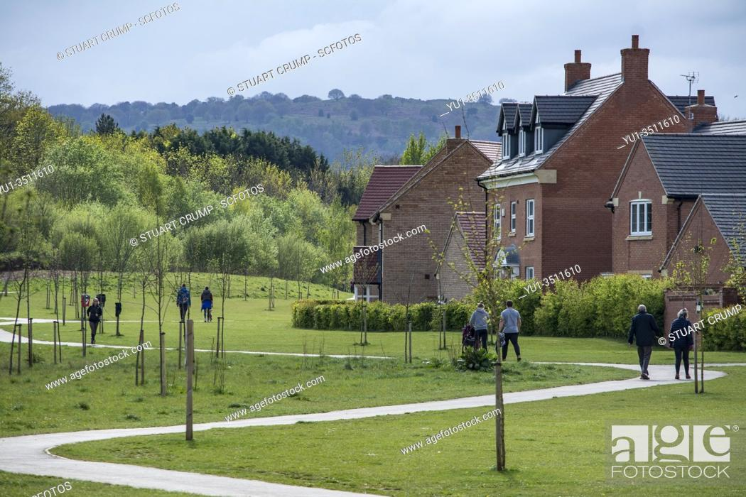 Stock Photo: People walking on a footpath in Loughborough Leicestershire observing social distancing during the Covid19 pandemic.
