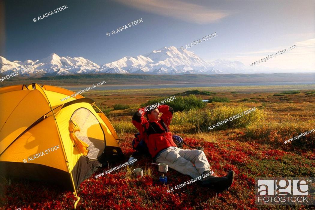 Photo de stock: Backpacker Tent Camping on Tundra Denali NP IN AK Fall Views Mt McKinley & AK Range.