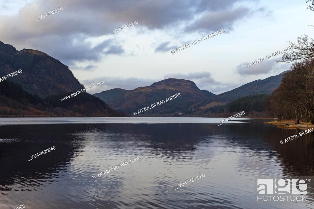 Stock Photo: Scotland has a lot of lotches, even more on the Highlands, calm waters and sunset.