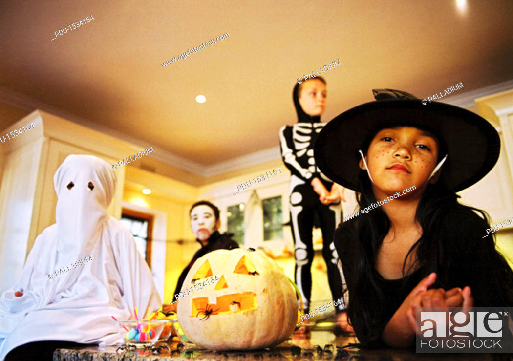 Stock Photo: low angle view of a group of children dressed in Halloween costumes.