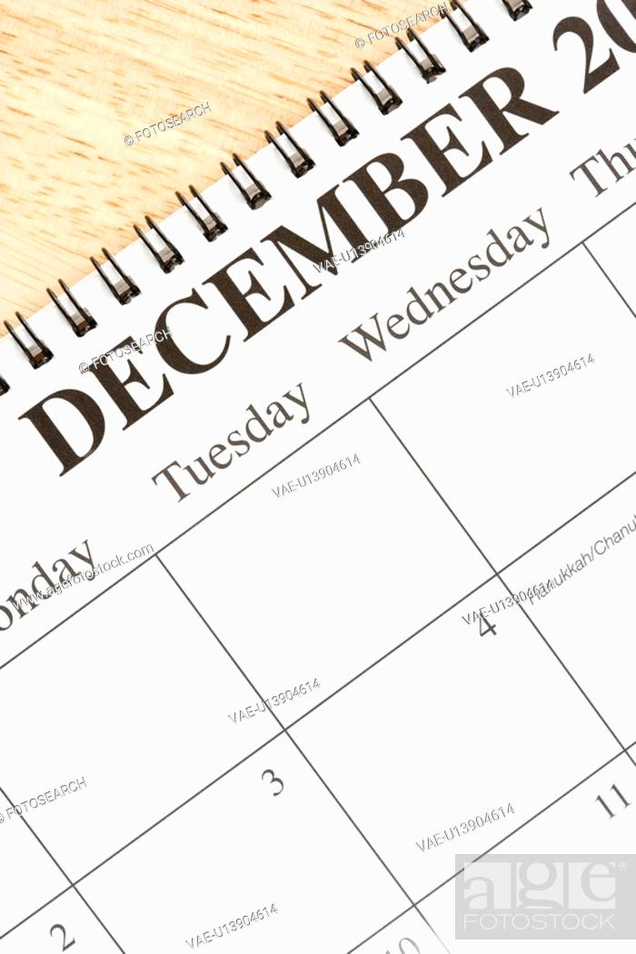 Stock Photo: Close up of spiral bound calendar displaying month of December.