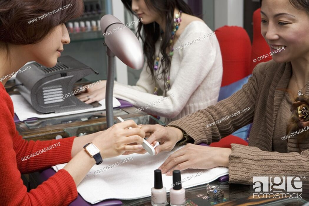 Stock Photo: Women getting manicures.