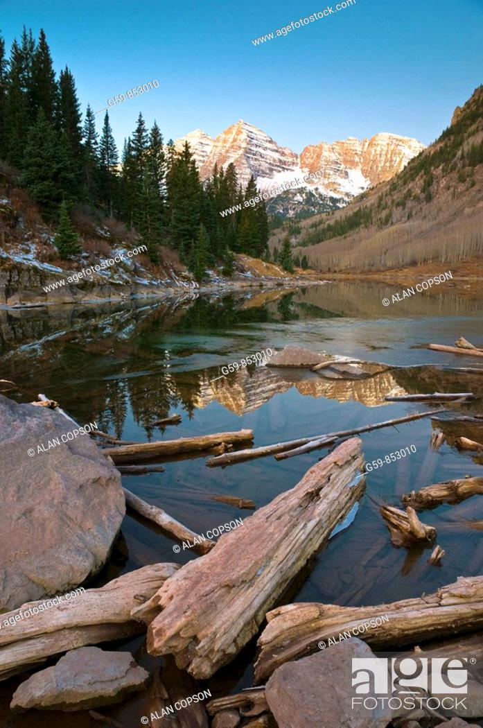 Stock Photo: USA, Colorado, Maroon Bells Mountain reflected in Maroon Lake.