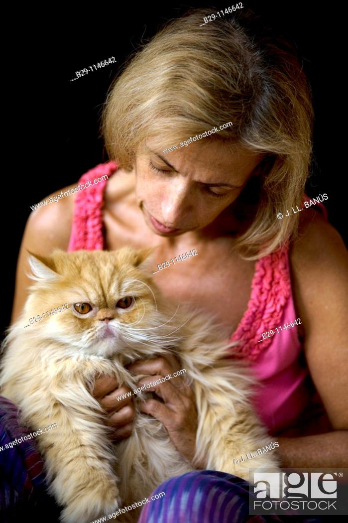Stock Photo: Woman with cat.