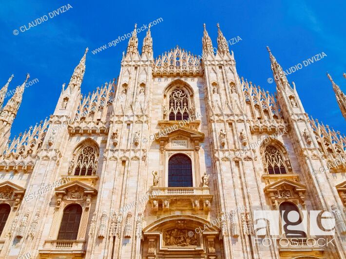 Photo de stock: Vintage looking Duomo di Milano meaning Milan Cathedral in Italy, with blue sky.