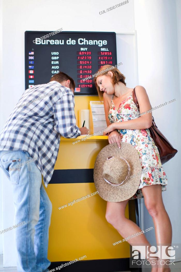 Stock Photo: Couple exchanging currency.