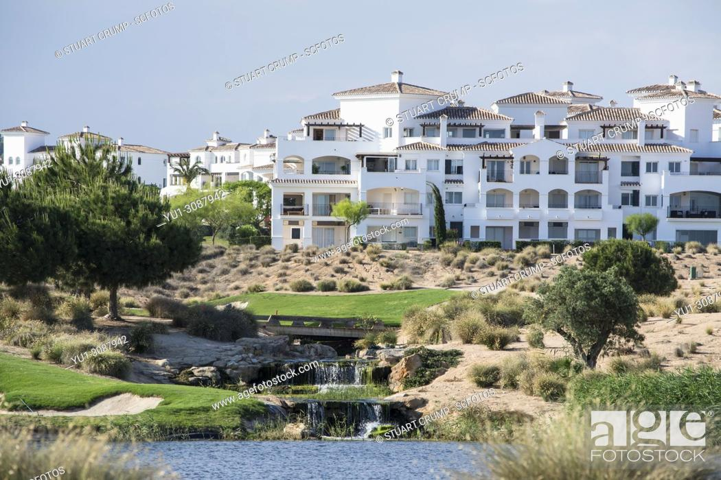 Stock Photo: Water hazard with a waterfall feature on the 7th hole at Hacienda Riquelme Golf Resort, Murcia, Spain.