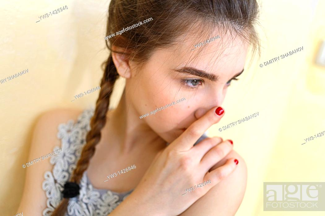 Stock Photo: Portrait of teenage girl indoors with braid.