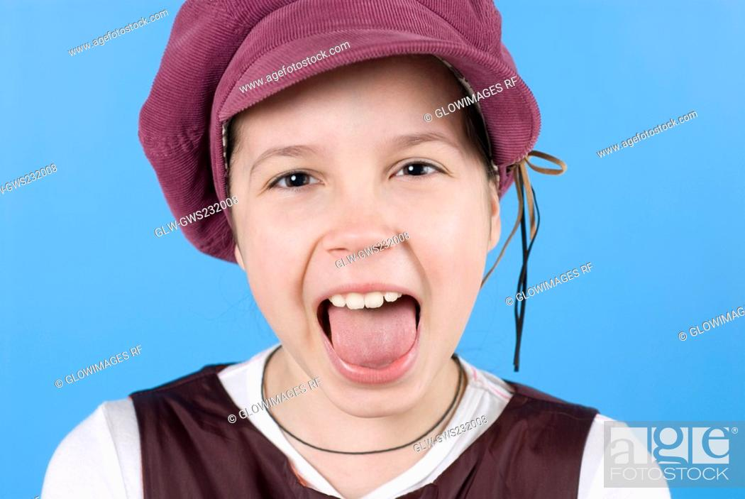 Stock Photo: Close-up of a girl with her open mouth.