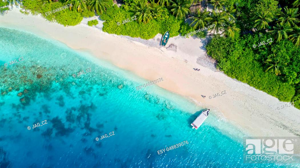 Stock Photo: Beautiful aerial view of Maldives jetty and tropical beach with palms and white sand. Travel and vacation concept.
